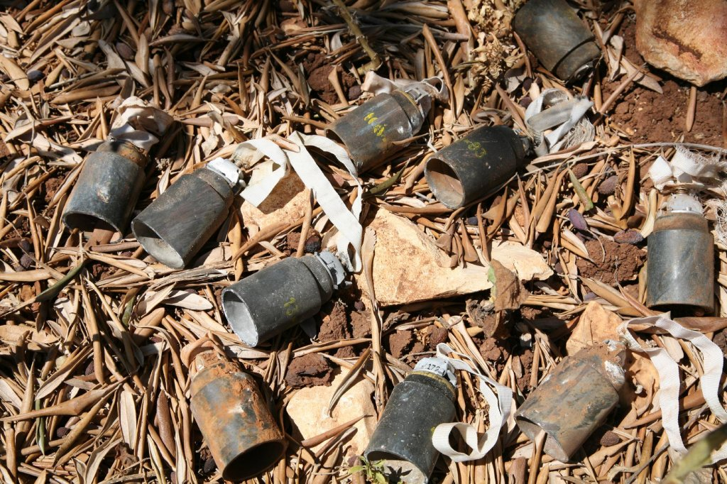 Cluster Bombs in Olive Grove. Photo Simon Conway