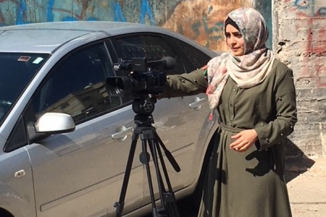 A woman filming as part of the Empowering women and challenging gender norms programme in Palestine