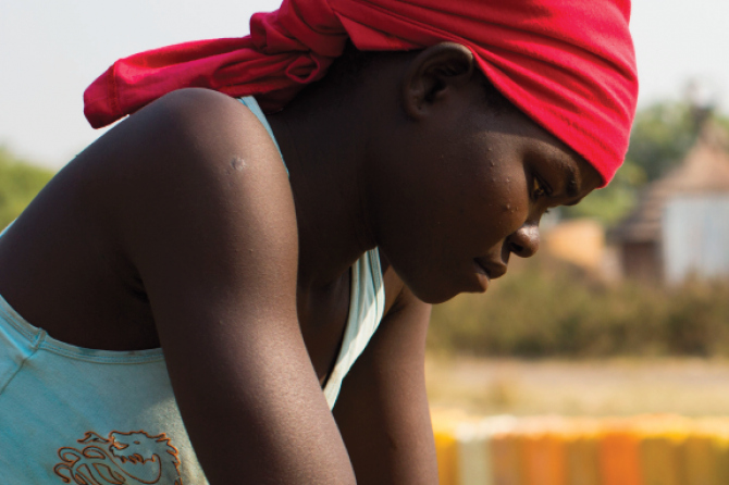 5174_woman-looking-down-south-sudan-nap1325-gender-programme.png